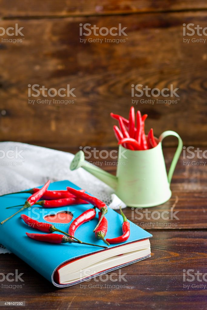 Notebook with heart and hot red peppers stock photo