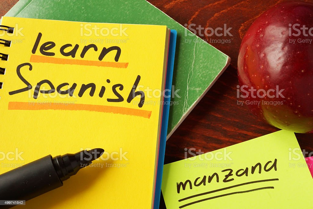 Notebook with learn Spanish  sign on a table. Education concept. stock photo