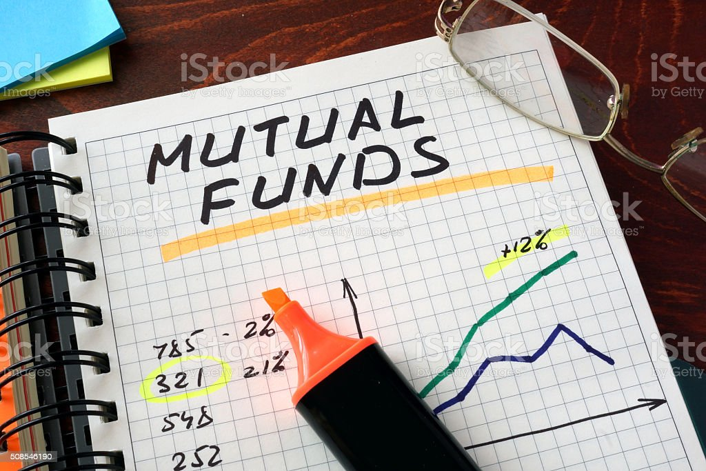 Notebook with mutual funds  sign on a table. Business concept. stock photo