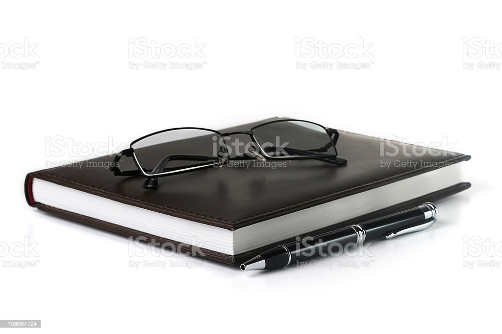 notebook with pen and glasses royalty-free stock photo