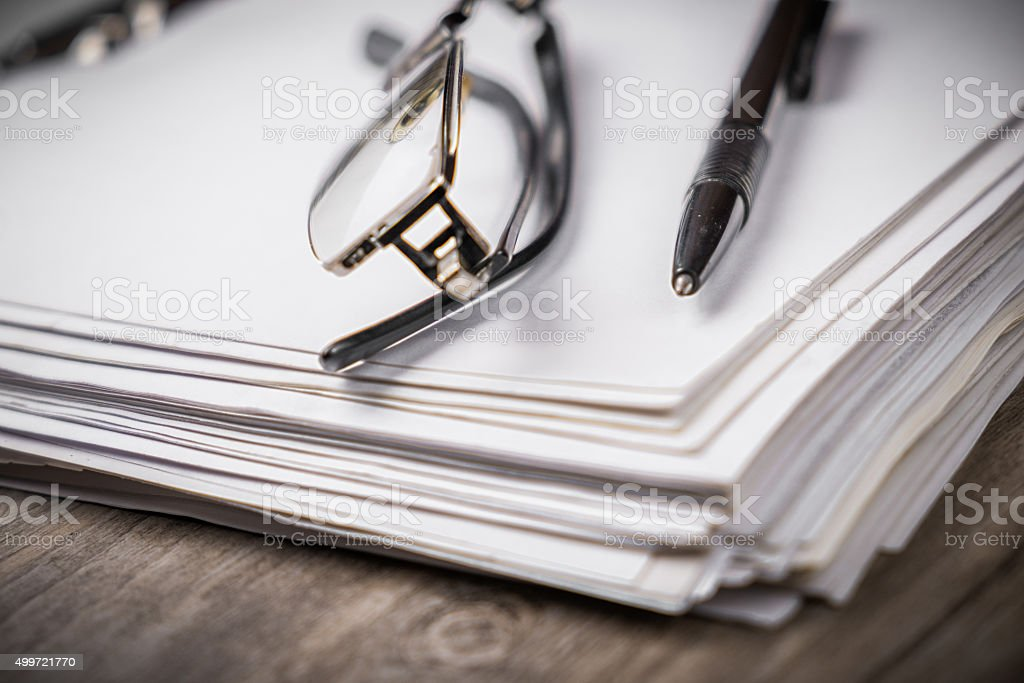 Notebook with pen and glasses stock photo