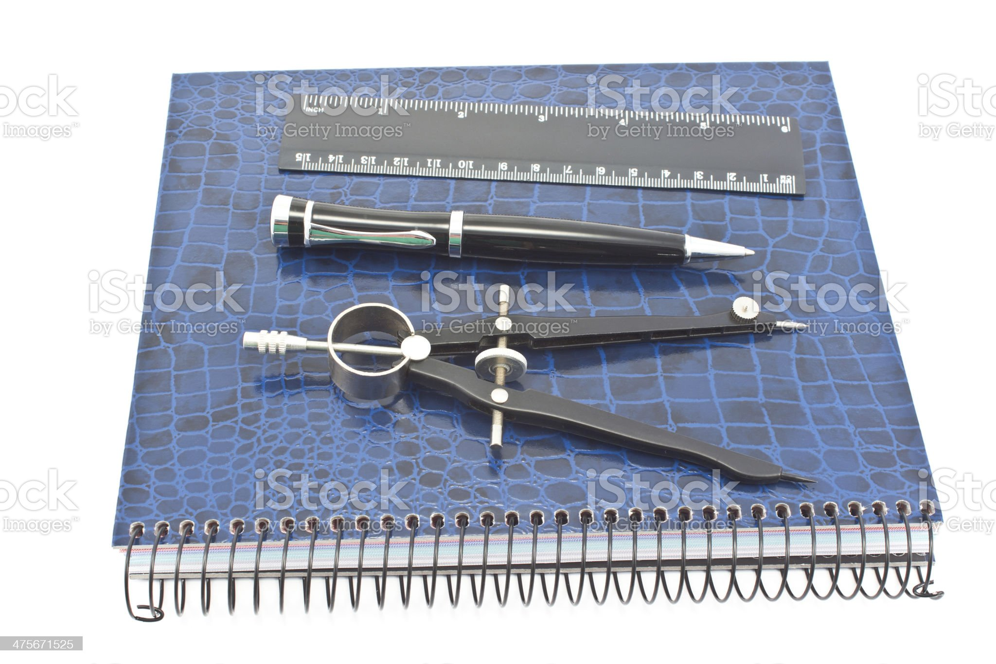 Notebook with pen, drawing compass and ruler isolated on white royalty-free stock photo
