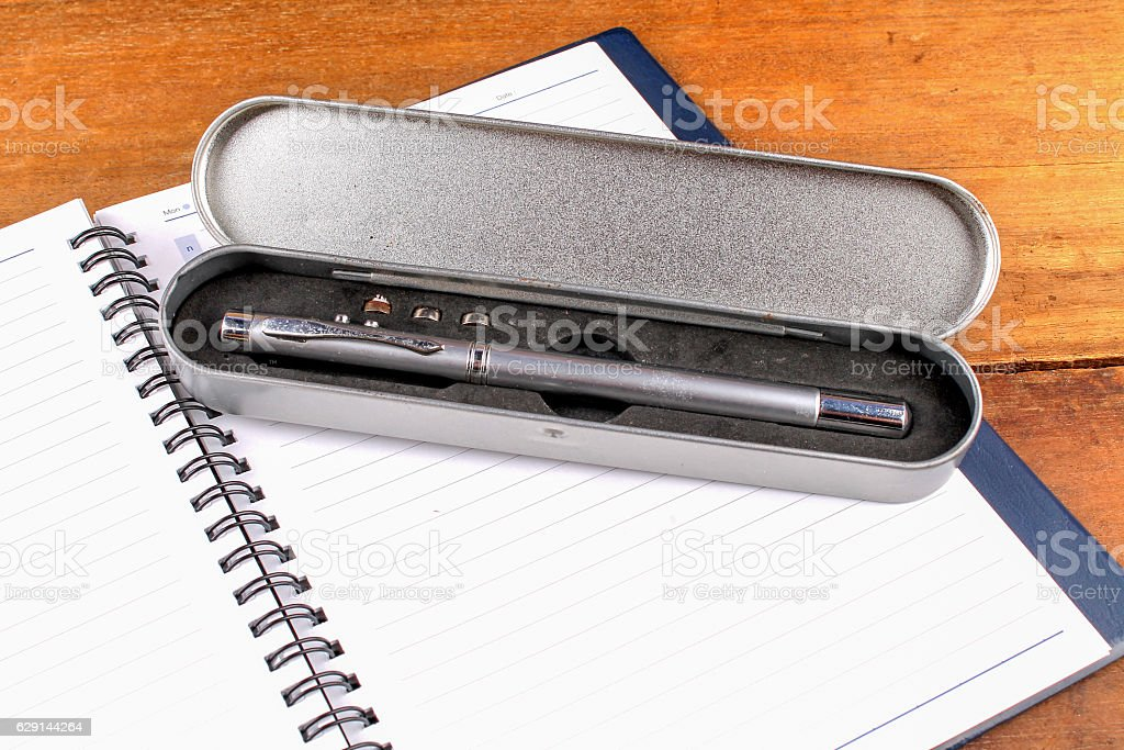 notebook with pen on old wooden table stock photo