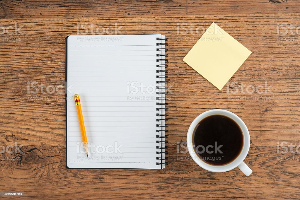 Notebook with pencil Adhesive Note and cup of coffee stock photo