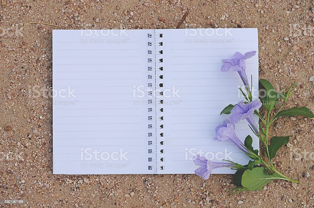 Notebook with Purple flower stock photo