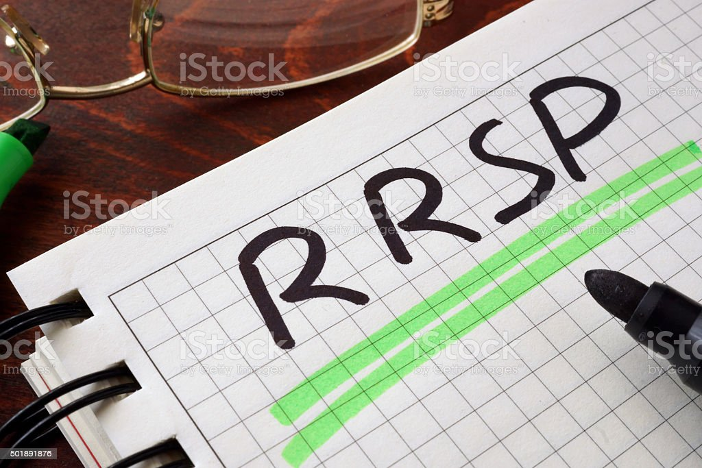 Notebook with  RRSP sign on a table. stock photo