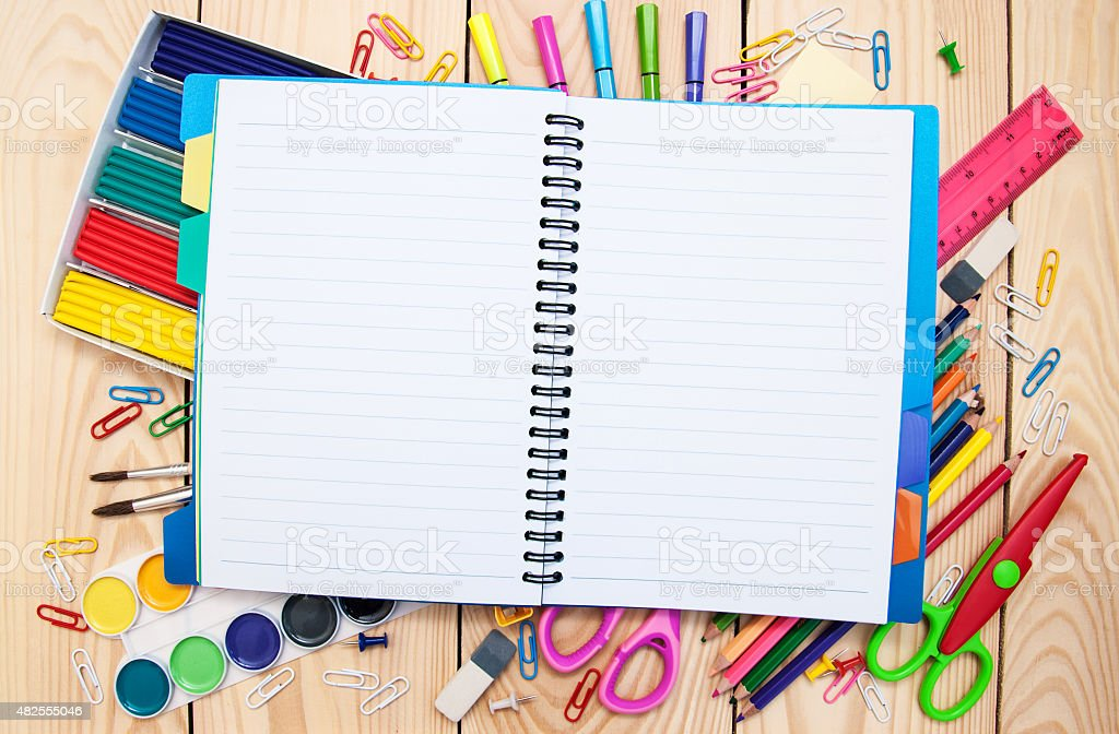 Notebook with school supplies stock photo