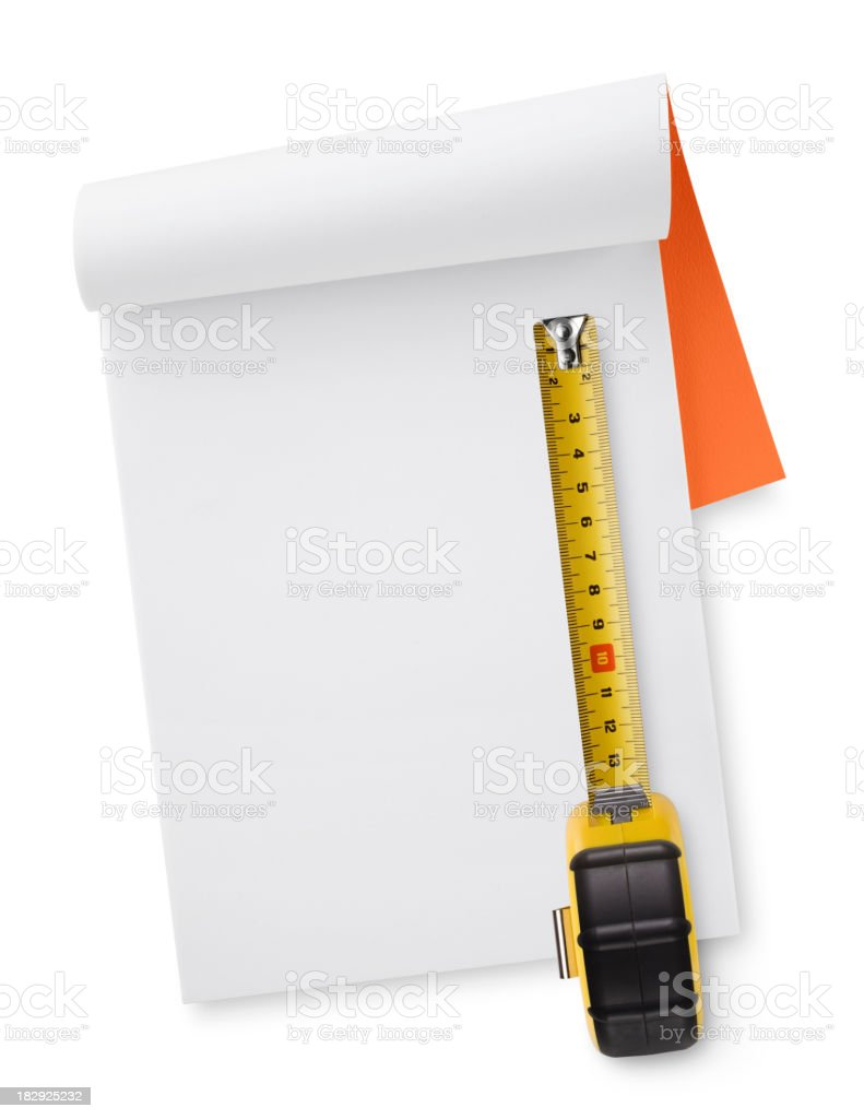 Notebook with tape measure royalty-free stock photo