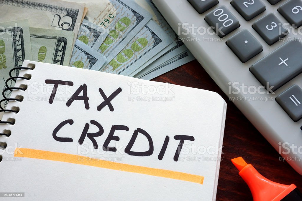 Notebook with tax credit  sign on a table. Business concept. stock photo