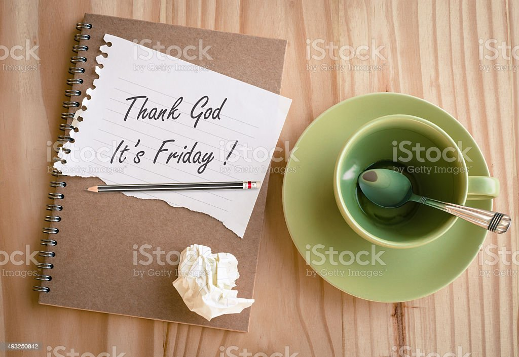 Notebook with text 'Thank God It's Friday!' stock photo