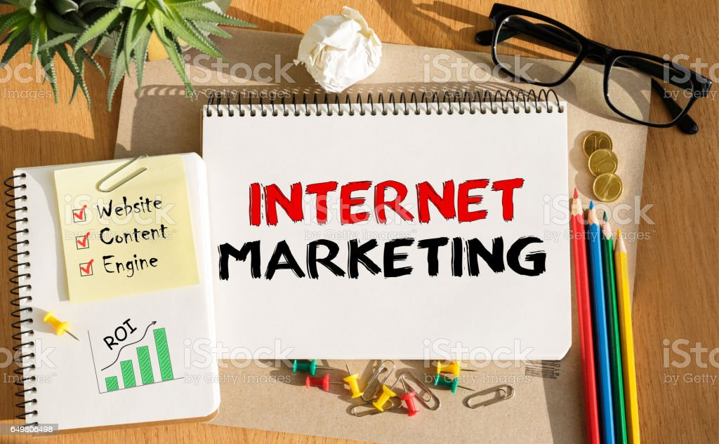 Notebook with Toolls and Notes about Internet Marketing stock photo
