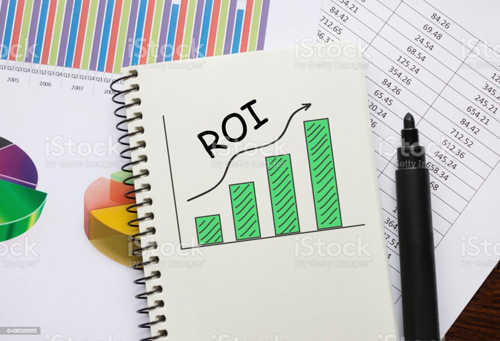 Notebook with Toolls and Notes about ROI stock photo