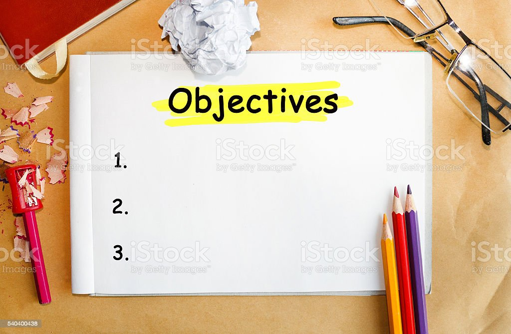 Notebook with Tools and Notes About Objectives stock photo