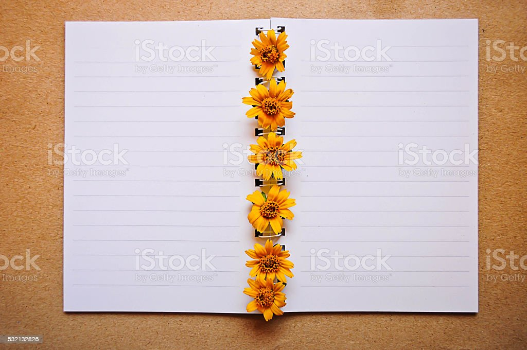 Notebook with yellow flower stock photo