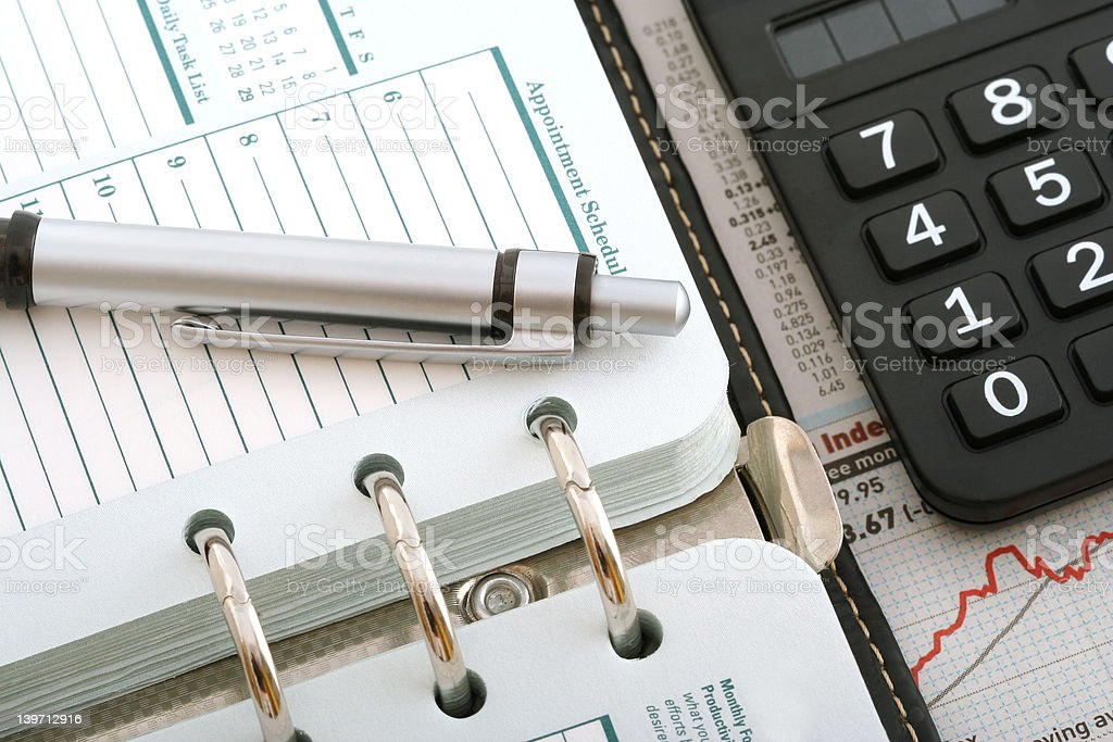 Notebook,Ballpen and Calculator on Stock Chart royalty-free stock photo