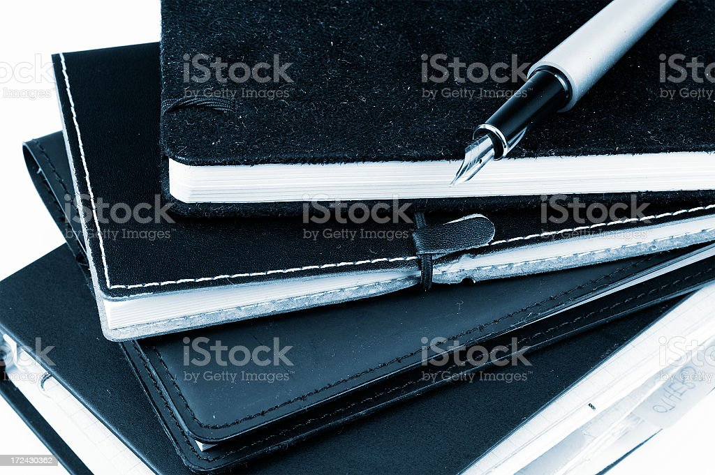 Notebooks and pen royalty-free stock photo