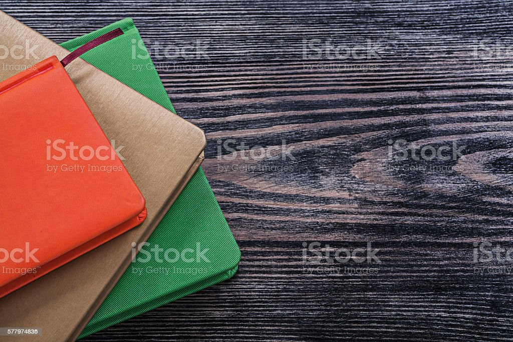 Note-books on vintage wooden board education concept stock photo