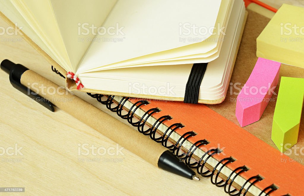 Notebooks, pen and stickers royalty-free stock photo