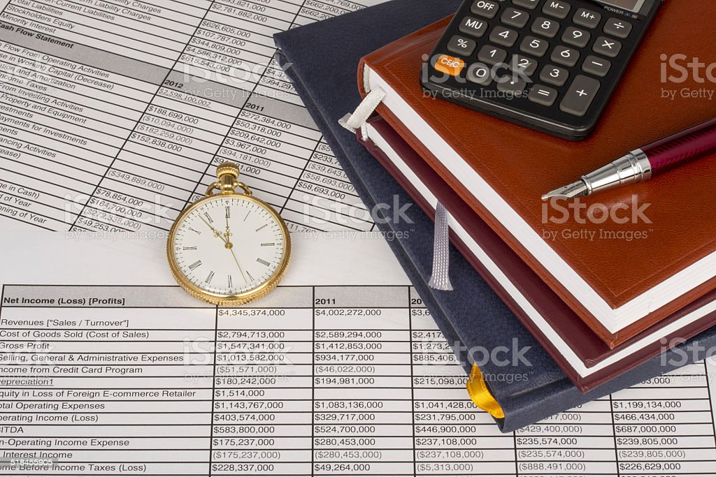 Notebooks with calculator, pen and pocket watch with accounting analysis stock photo