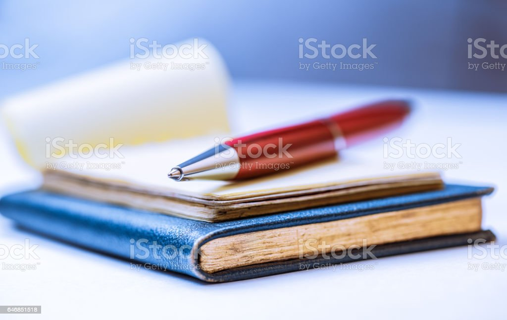 Notebooks with red pen stock photo