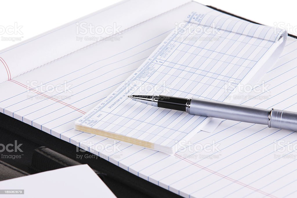 Notepad and cheque book stock photo