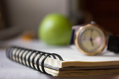 notepad and clock on the table