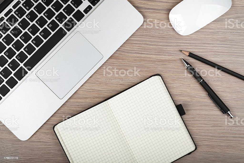 Notepad and laptop on wood table royalty-free stock photo