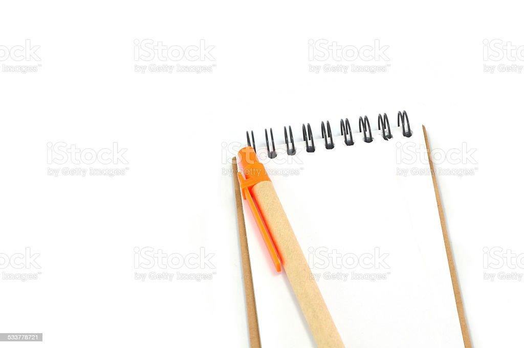 Notepad and orange pen Isolated on White Background stock photo