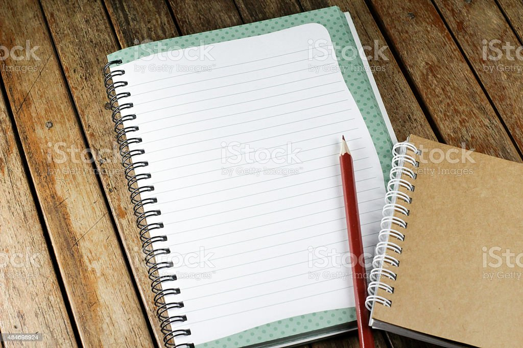 notepad and pencil on a desk stock photo