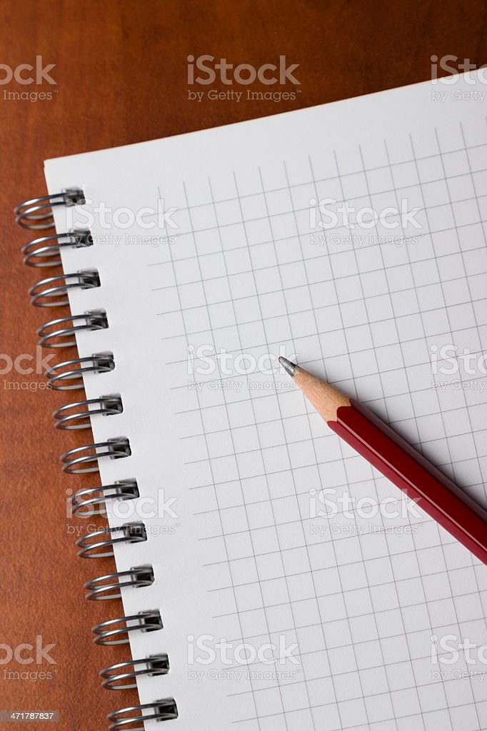 Notepad and pencil on desk royalty-free stock photo