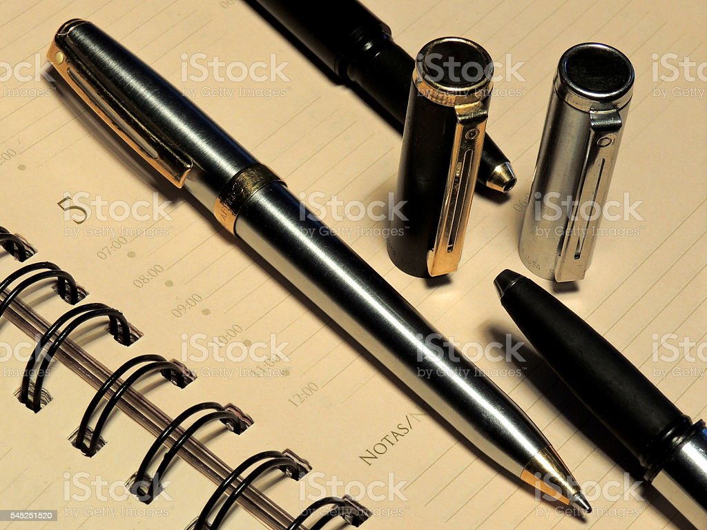 Notepad and pens stock photo