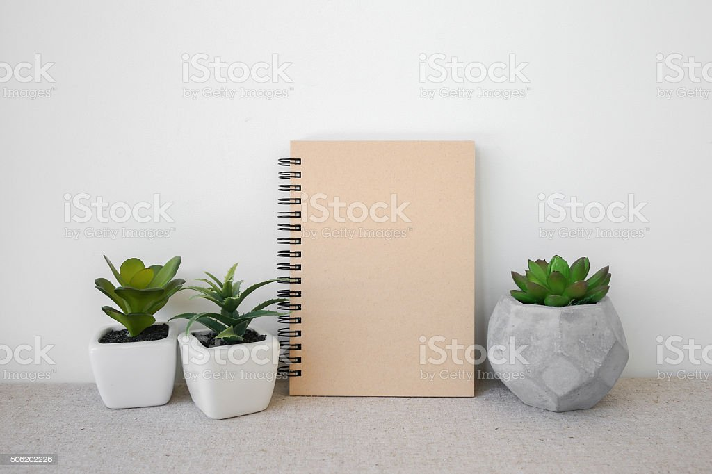 Notepad and succulents pots, room interior mockup stock photo