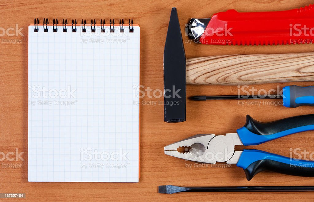 Notepad and tool top view. royalty-free stock photo