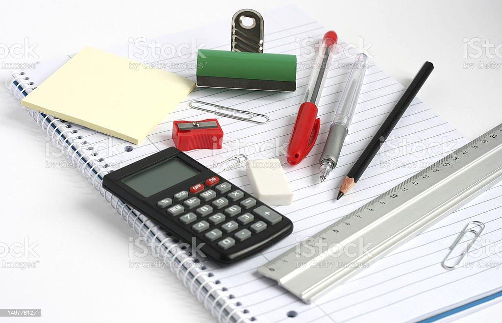 notepad calculator ruler pens pencil bulldog clip royalty-free stock photo
