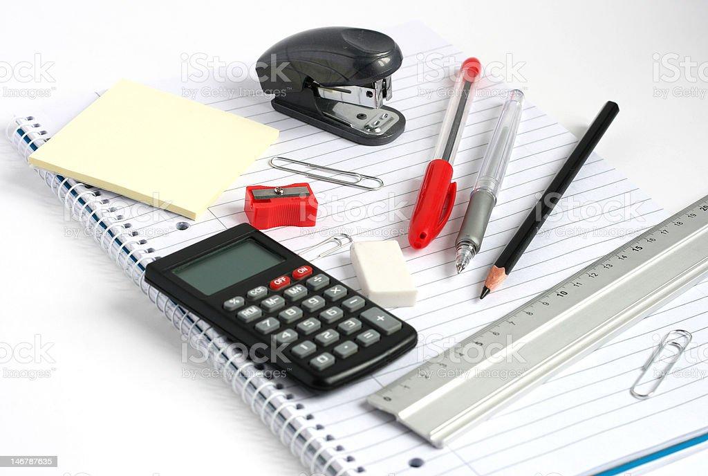 notepad calculator ruler pens pencil stapler stock photo