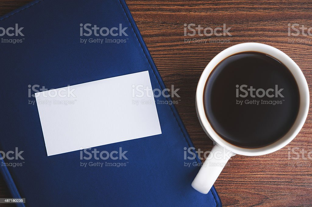 Notepad, calling card and coffee cup stock photo