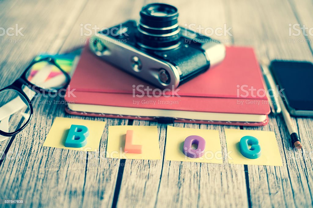 Notepad, camera and smartphone stock photo