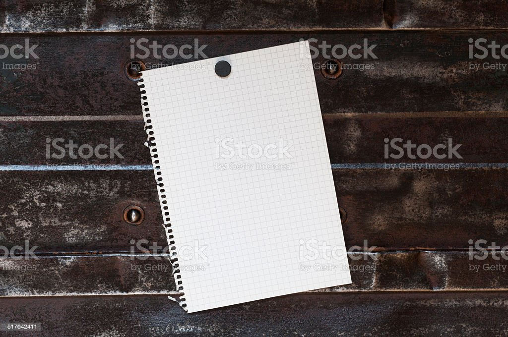 Notepad in front of a metal background stock photo