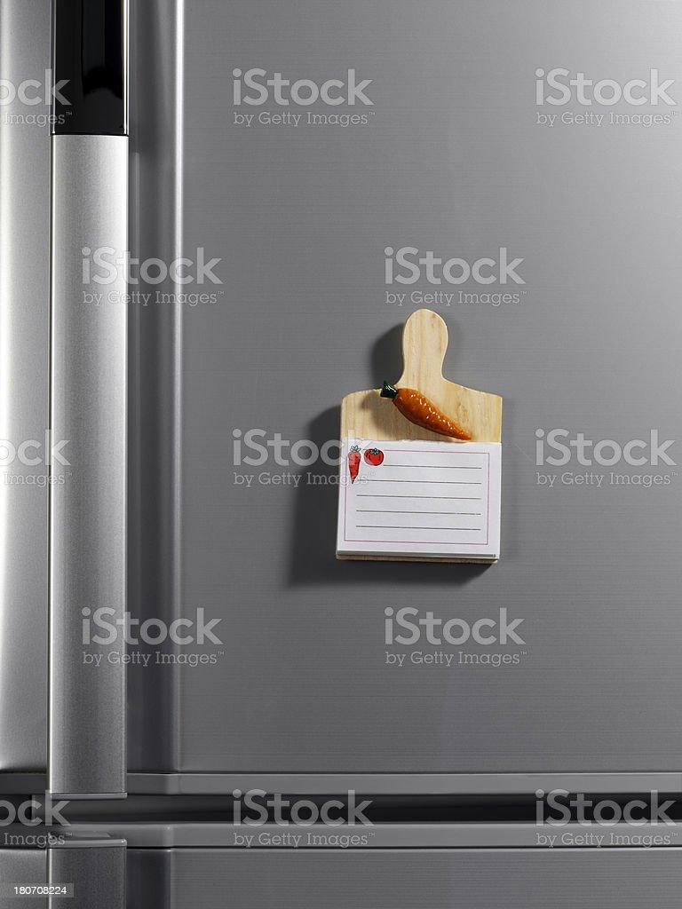 Notepad on the fridge stock photo