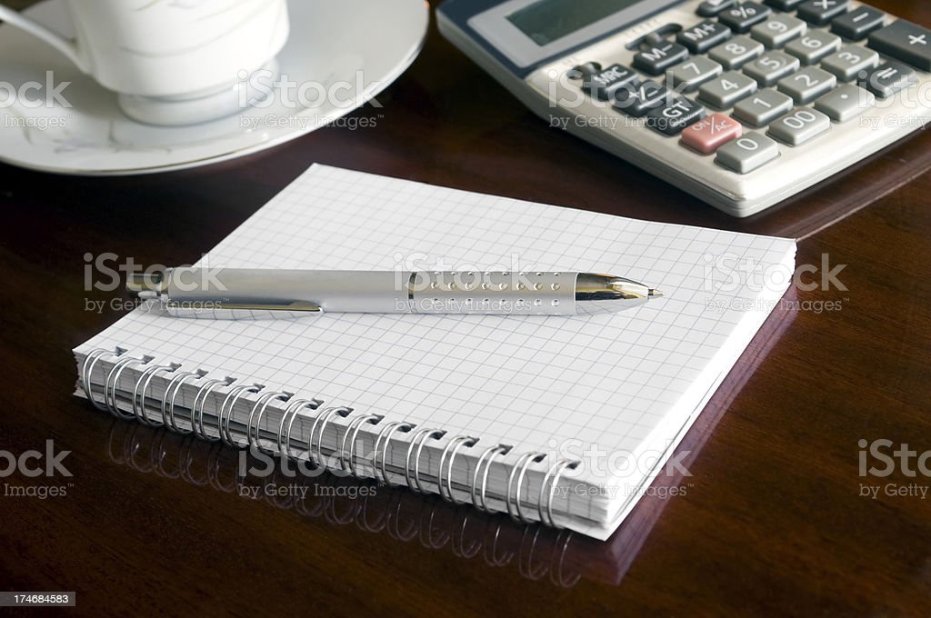 Notepad, pen, calculator and coffee royalty-free stock photo