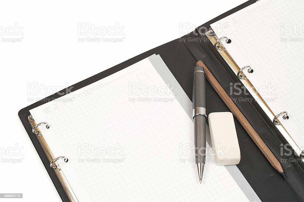 Notepad, pen, pencil and eraser.