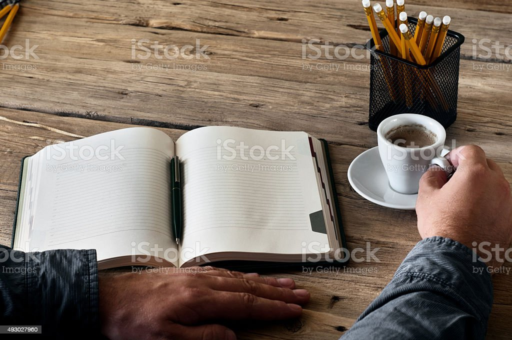 Notepad with blank pages on wooden table stock photo