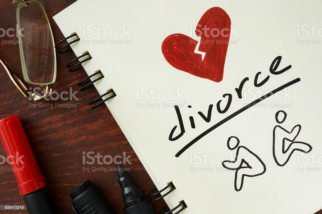 Notepad with divorce on the wooden table. stock photo