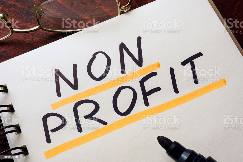 Notepad with non profit on the wooden table. stock photo