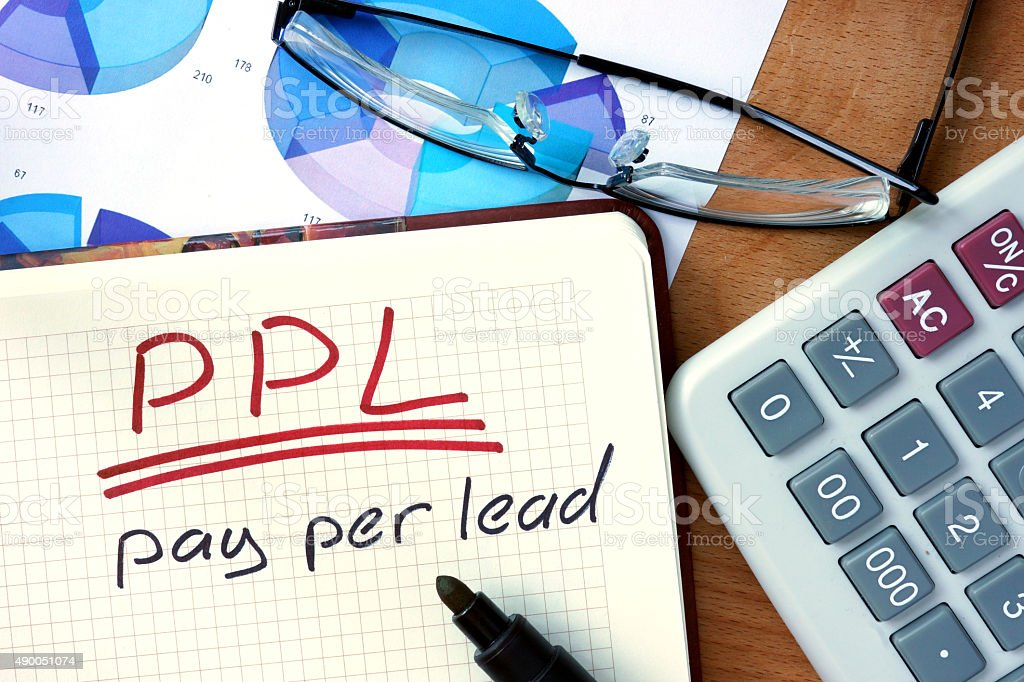 Notepad with Pay per lead PPL on office wooden table. stock photo
