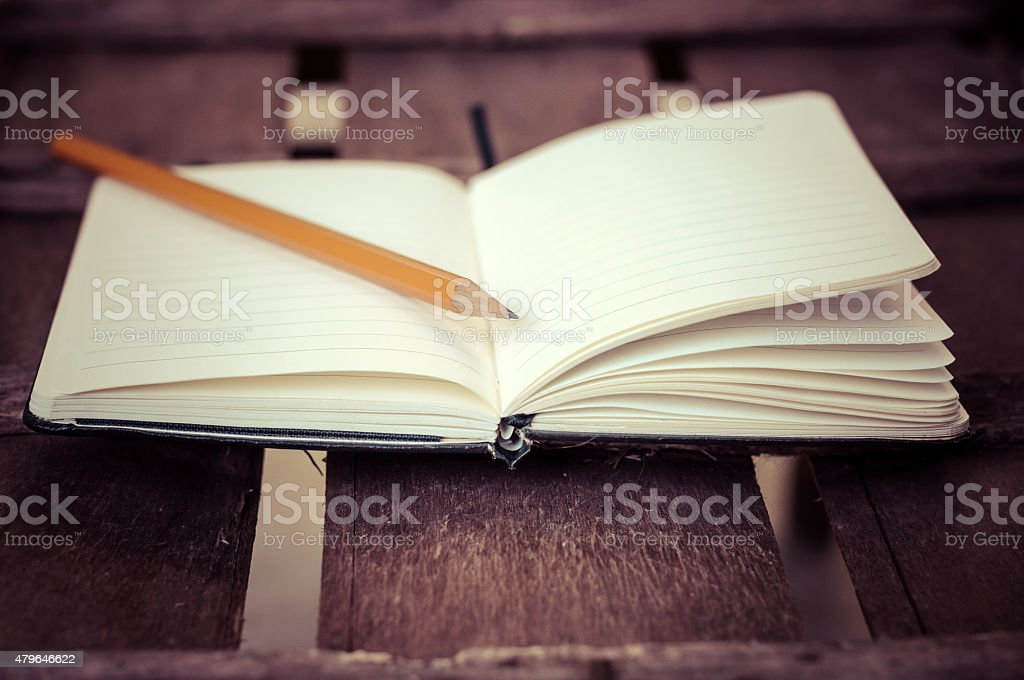 notepad with pen on wood table stock photo