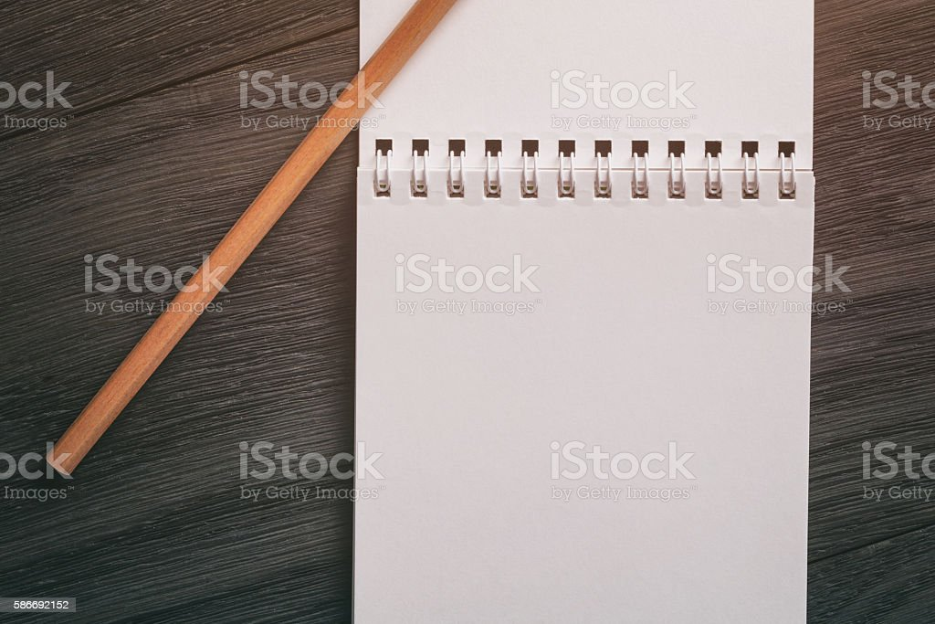 notepad with pencil on wood table stock photo