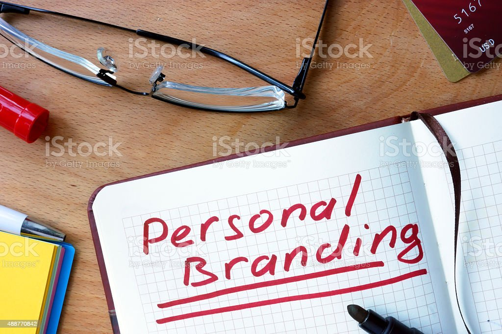 Notepad with Personal Branding  on office wooden table. stock photo