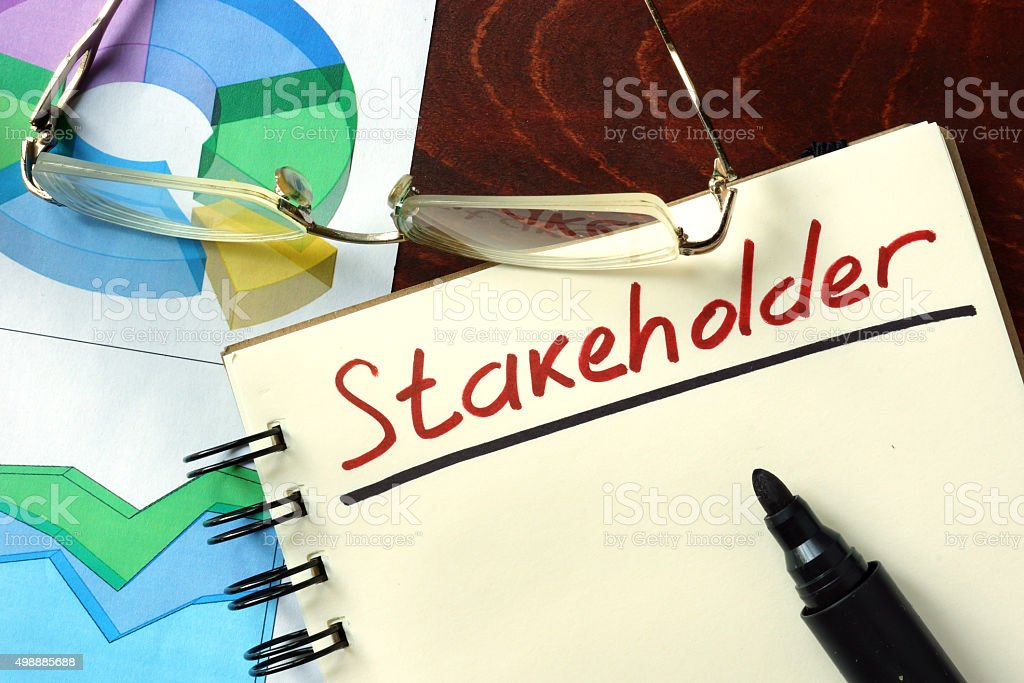 Notepad with Stakeholder on the wooden table. stock photo