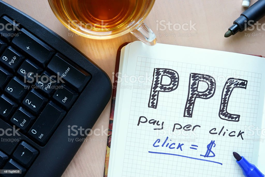 Notepad with word PPC pay per click concept and marker. stock photo